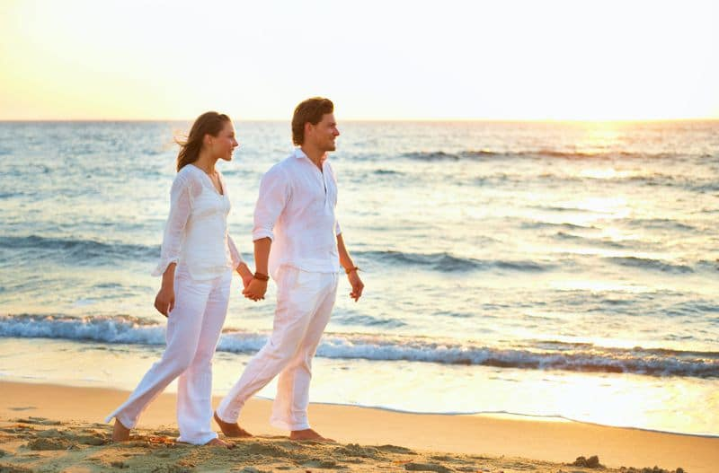 couple on beach at casa linda